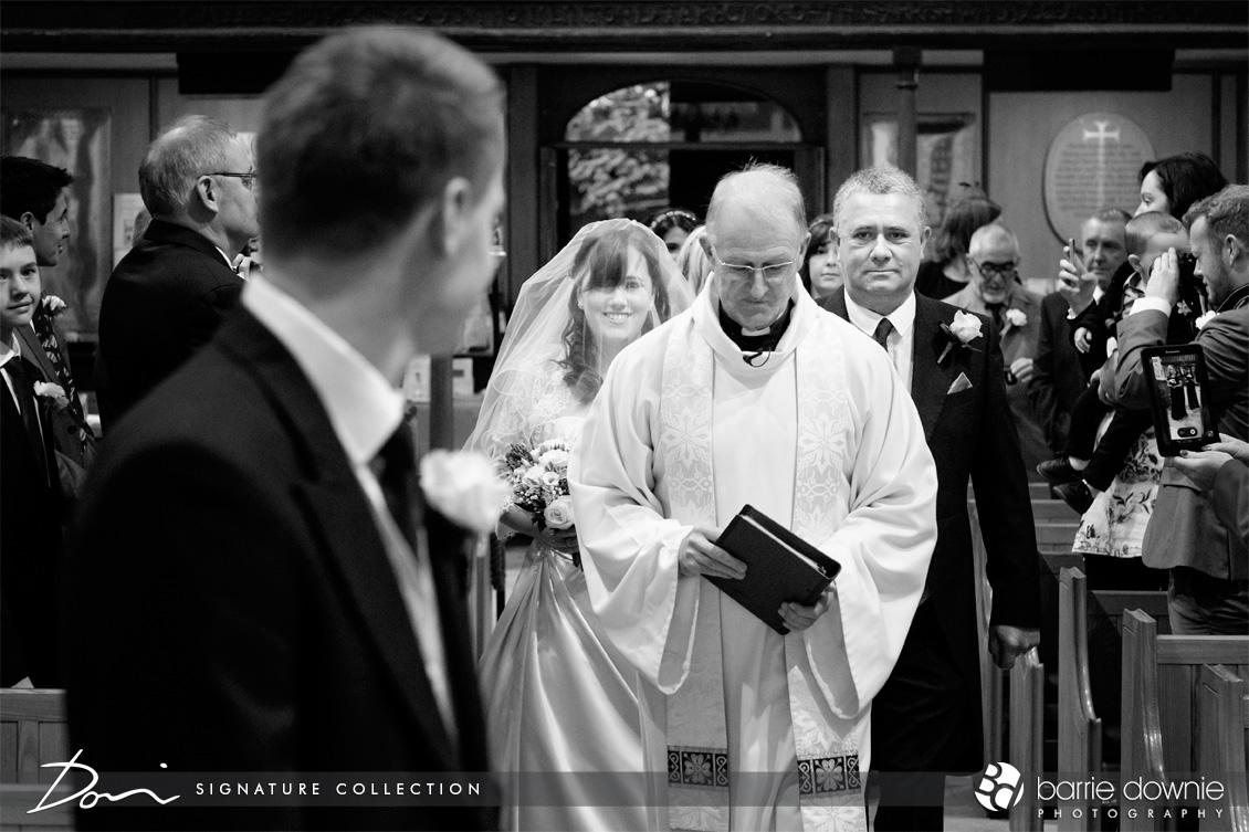 bride-walking-up-ailse-sussex-church-wedding