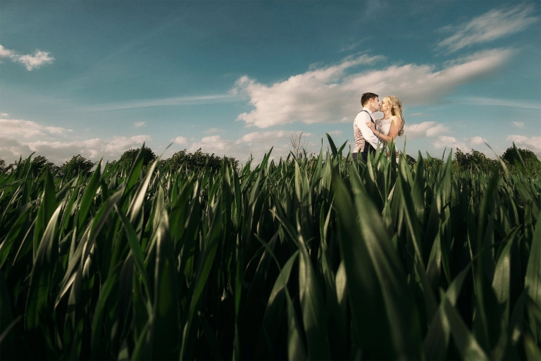 southend-barns-bride-and-groom-kissing-in-field-2(pp_w768_h512)